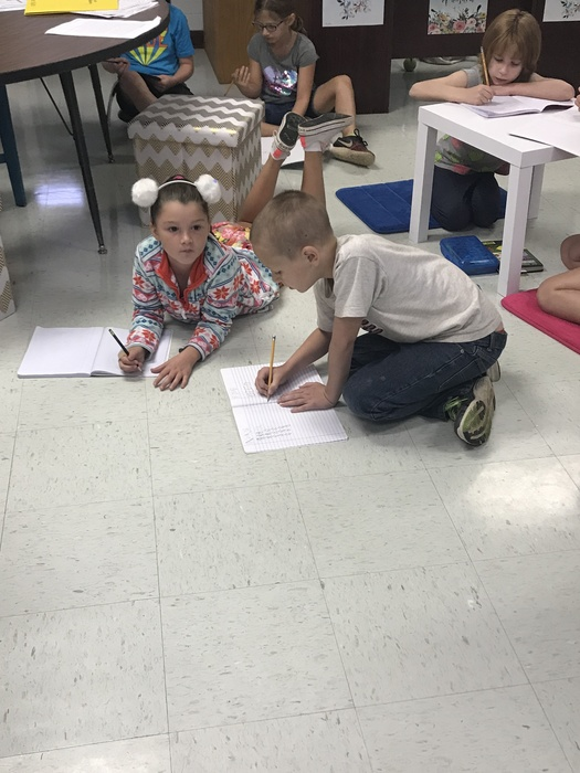 Teamwork makes the dream work during Mrs. White's math lessons. Students collaborated together and used hands on objects to make math problems come to life and learn more about division today! Mrs. White says it was a major success.